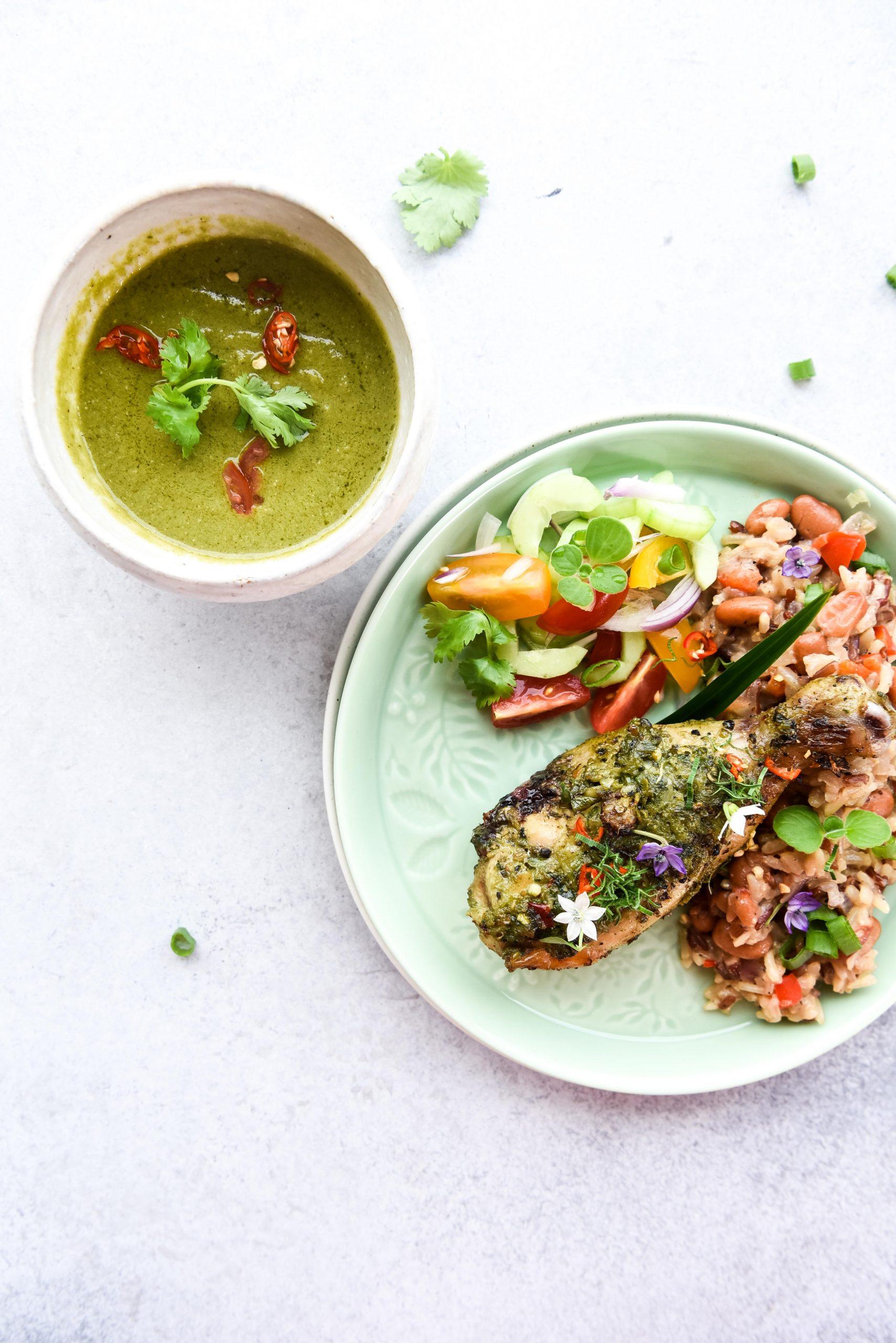 White bowl, green sauce, chicken drumstick